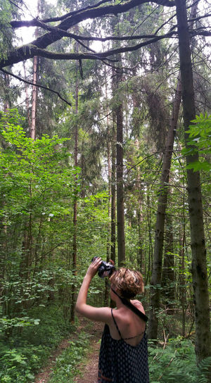 Taking pictures in the forest Tree Plant Forest Land One Person Growth WoodLand Standing Photographing Photography Themes Day Activity Nature Holding Leisure Activity Real People Technology Waist Up Camera - Photographic Equipment Lifestyles Outdoors Photographer Young Adult Woman Woods Russia