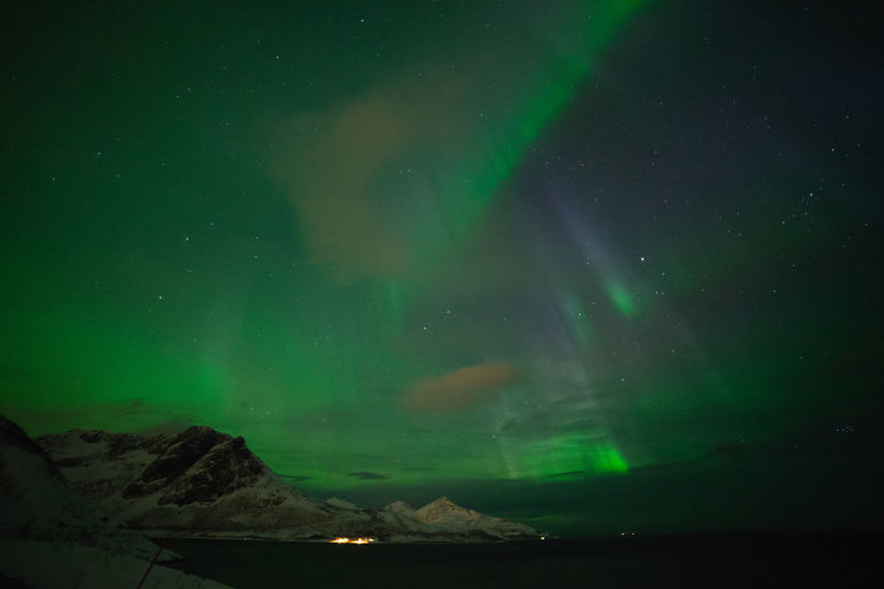 Aurora Borealis over Grøtfjord Geomagnetic Disturbance Kp-index Northern Lights Polar Lights Astronomy Aurora Polaris Awe Beauty In Nature Fjord Geomagnetic Storm Green Color Idyllic Natural Phenomenon Nature Night No People Outdoors Scenics - Nature Sea Sky Solar Storm Space Star - Space Tranquil Scene Water