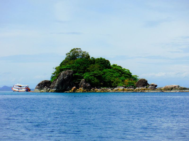 Wanna get away? Vacation Time Faraway Places Remote Island Idyllic Sunny Day Out At Sea Islandscape Going Snorkeling Bright Seascape Tropical Island Tropical Paradise Distant Island Lush Tourist Boat Trip Tourist Destination Vacation Destination Koh Chang Thailand Ko Chang Island View  Island EyeEm Thailand Travel Destinations Travel Thailand