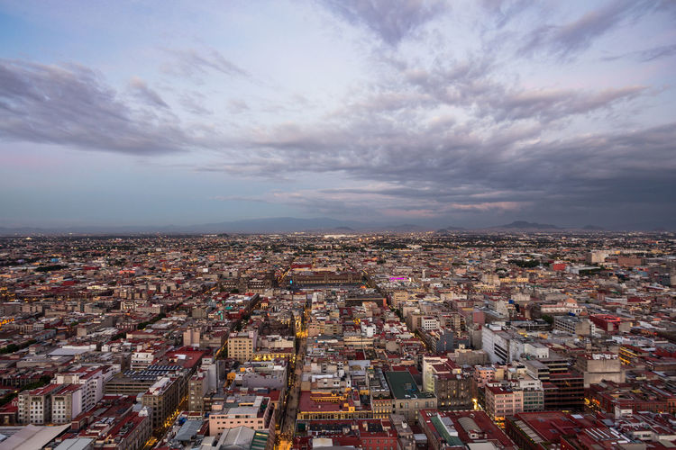Blue Hour Ciudad De México Zócalo Aerial View Architecture Building Building Exterior Built Structure City Cityscape Cloud - Sky Crowd Crowded Day Dusk High Angle View Nature Outdoors Residential District Settlement Sky Skyscraper Sunset TOWNSCAPE Travel Destinations This Is Latin America