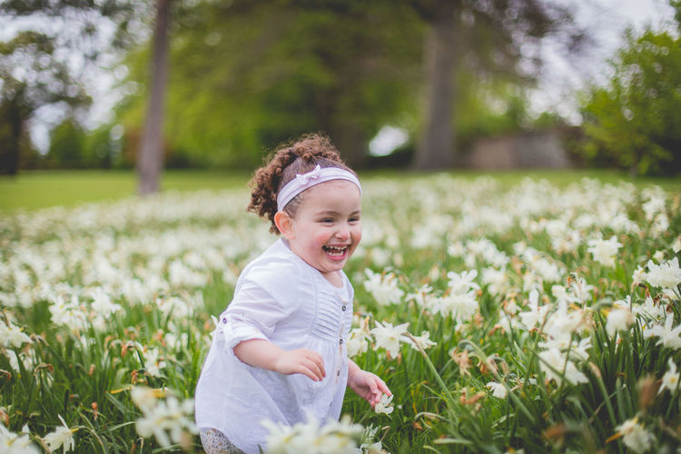 Portrait Of Happy Girl In A Meadow