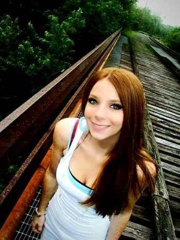 Portrait Looking At Camera Young Adult Beauty Sunlight Smiling Young Women Happiness Only Women Outdoors Day Nature Beautiful Woman Train Tracks