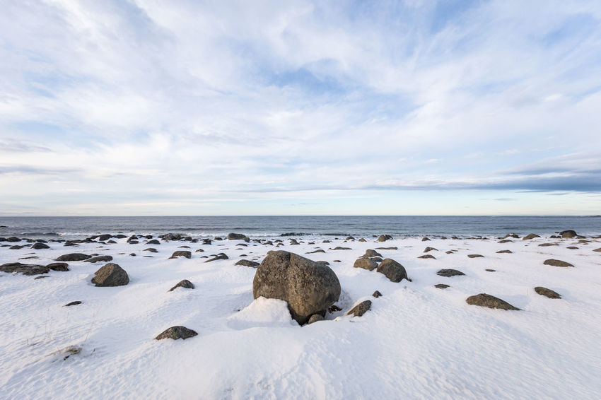 Rocks on snow covered beach against open sea Beach Beauty In Nature Cloud - Sky Cold Temperature Day Dramatic Landscape Dramatic Sky Escapism Frozen Horizon Over Water Landscape Lofoten And Vesteral Islands Nature No People Norwegian Sea Outdoors Polar Climate Remote Rock - Object Scenics Sea Sky Snow Wide Angle Winter The Great Outdoors - 2017 EyeEm Awards