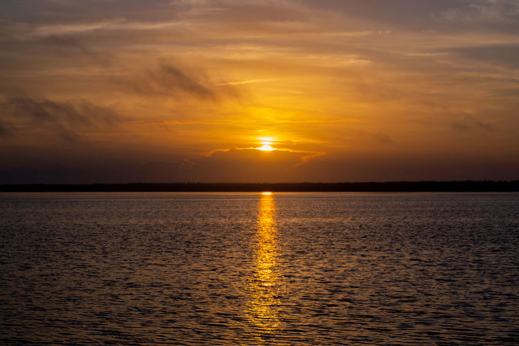 Crack of Dawn Dawn Morning Picturesque Color Photography Sunrise Lake Landscape Light And Shadow Water Low Tide Sunset Beauty Horizon Gold Colored Backgrounds Sun Romantic Sky Reflection Lake Water Surface Atmospheric Mood Cumulus Dramatic Sky