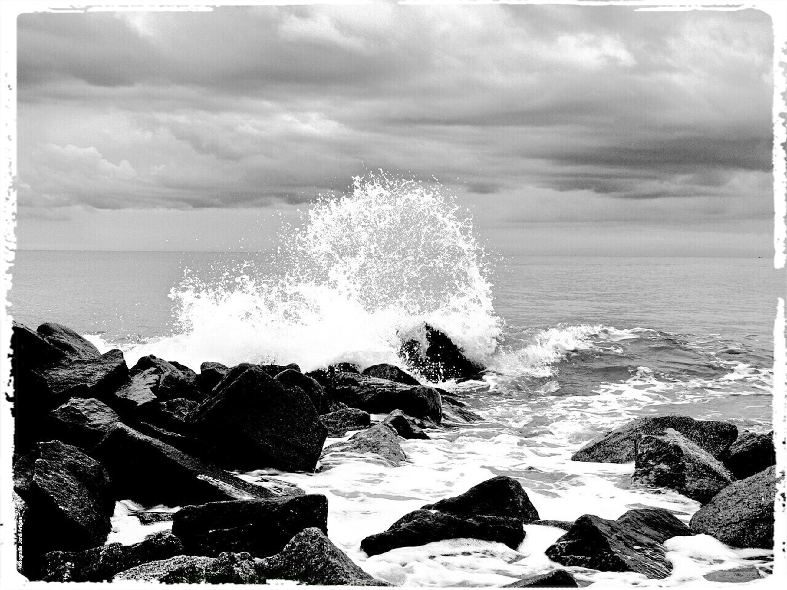sea, water, horizon over water, transfer print, scenics, beauty in nature, rock - object, sky, tranquil scene, tranquility, auto post production filter, nature, wave, rock, rock formation, cloud - sky, beach, shore, idyllic, surf