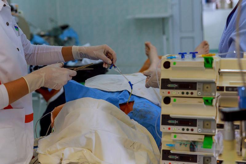 Doctors Treating Patient In Operating Room