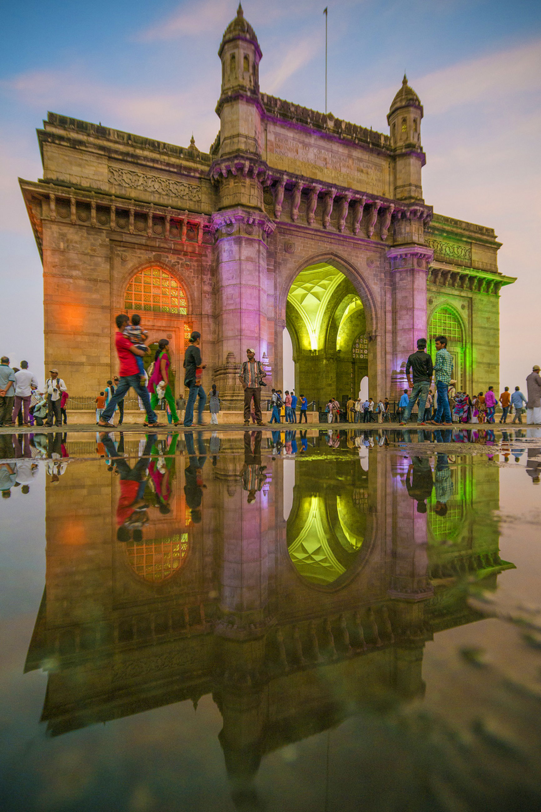 architecture, water, built structure, building exterior, waterfront, reflection, fountain, large group of people, travel destinations, sky, tourism, art and craft, famous place, sculpture, art, incidental people, statue, pond, travel