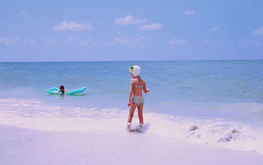 """""""The Beach"""" 1969 Kids Being Kids Beach Beauty In Nature Child Childhood Family Girls Holiday Horizon Horizon Over Water Land Leisure Activity Motion Outdoors Real People Sea Sky Trip Two People Vacations Water"""