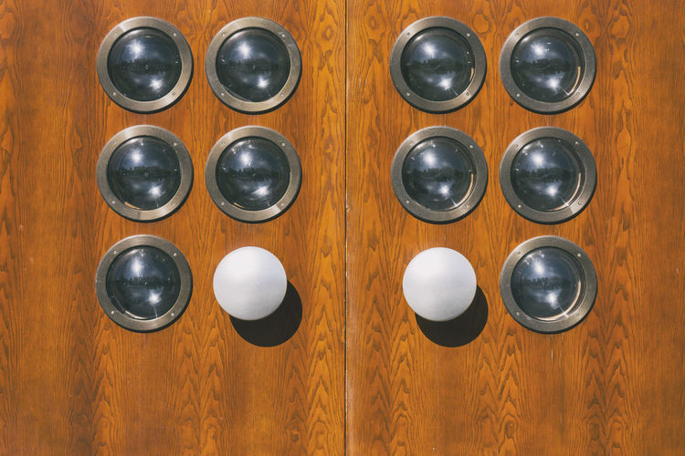 Round Glass Holes in Wooden Door Architecture Berlin Copy Space Entrance Germany 🇩🇪 Deutschland Horizontal Arrangement Backgrounds Brown Close-up Color Image Day Design Door Entrance Glass - Material Group Of Objects In A Row No People Order Outdoors Shape Side By Side Still Life Wood - Material