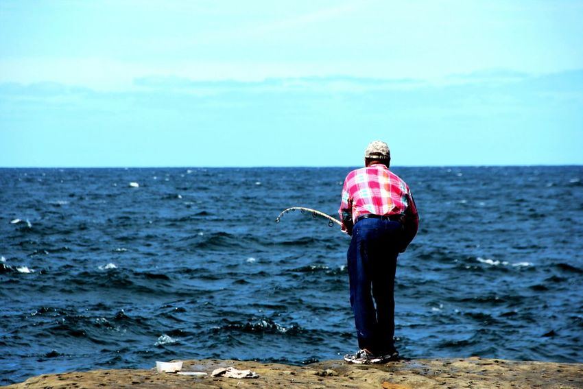 The Fisherman Sea Beach Horizon Over Water Rear View Standing Water Shore Full Length Sand Tranquil Scene Tranquility Scenics Solitude Relaxation Idyllic Escapism Rippled Sky Calm Casual Clothing PeopleOfTheOceans Taking Photos Enjoying Life Fisherman