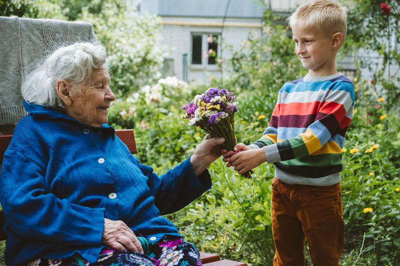 Reunited, family, togetherness, relationships, meeting, embracing. grandson visit grandmother
