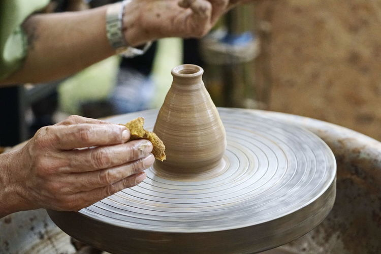 Cropped Hands Of Man Making Pot