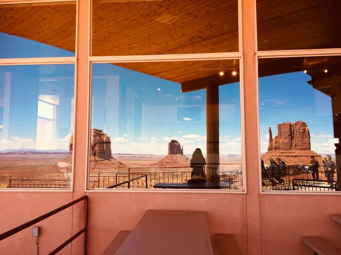 Reflection Monument Valley Arizona Destination The View Hotel Monument Valley Architecture Built Structure Sky Nature Railing Indoors  No People Seat Water Land Travel Destinations Scenics - Nature Architectural Column