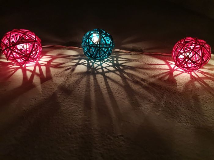 Illuminated christmas lights on table