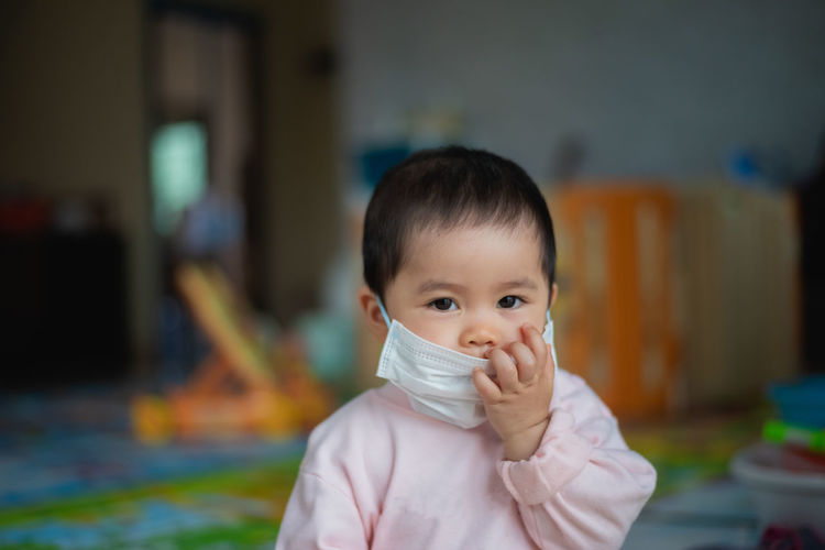 Portrait of baby girl wearing mask