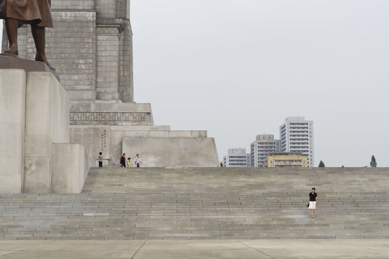 North Korean woman standing at the stairs of the tower of the Juche Idea, a 170-meter tall monument. It is presumed to be modeled on the Washington Monument, which it surpasses in height by less than a metre. Hello World Capture The Moment North Korea DPRK Travel EyeEm Best Shots Eye4photography  Woman People