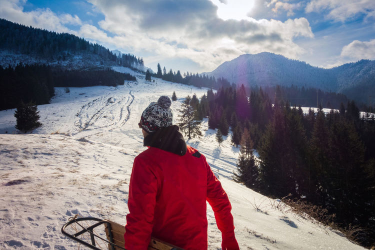 Winter scenery Winter Snow Mountain Real People Cold Temperature Rear View Beauty In Nature Scenics - Nature One Person Leisure Activity Sky Cloud - Sky Nature Tree Plant Warm Clothing Mountain Range Snowcapped Mountain Outdoors Sleigh Slope Winter Wintertime Sonyrx100 Adult
