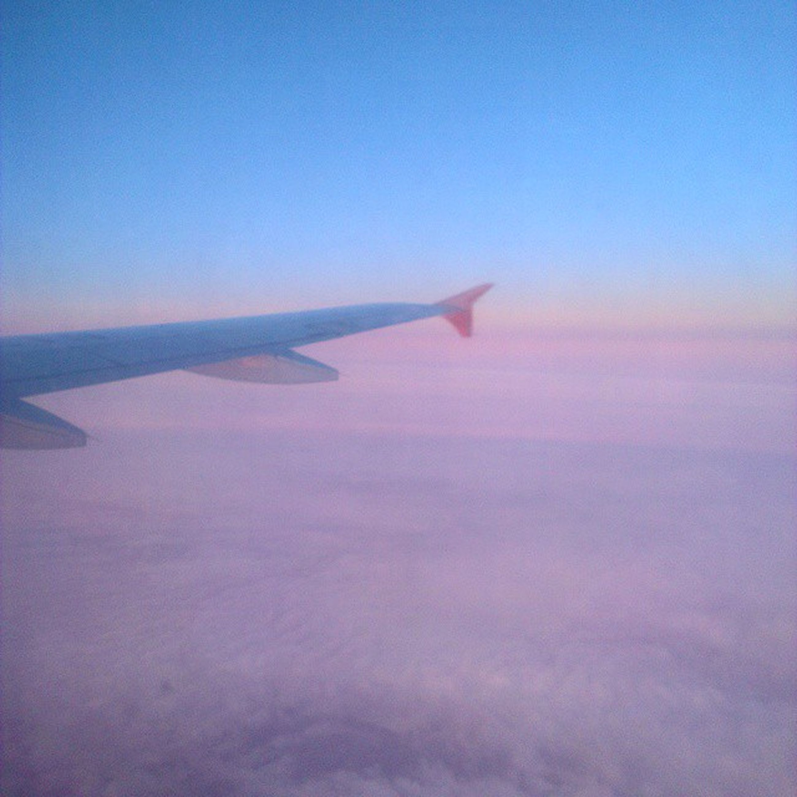 flying, airplane, air vehicle, transportation, aircraft wing, mode of transport, aerial view, part of, blue, cropped, mid-air, travel, sky, journey, on the move, copy space, nature, scenics, beauty in nature, public transportation