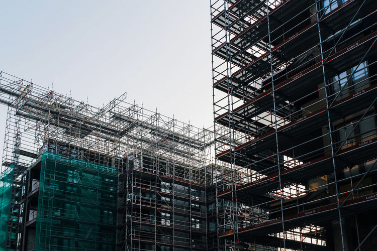 Architecture Built Structure Building Exterior Building Low Angle View Construction Industry Construction Site Industry Scaffolding Sky No People Incomplete Development Outdoors Nature City Day Copy Space Modern Crane - Construction Machinery