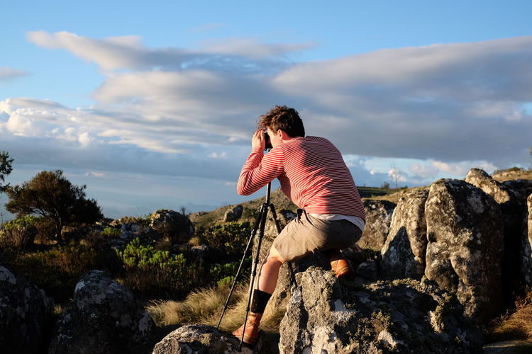 Sunset missions in Nyanga, Zimbabwe. Africa Arms Outstretched Beauty In Nature Casual Clothing Cloud - Sky Landscape Lifestyles Man Nature Photography Outdoor Photography Person Photographer Photoshoot Rock - Object Rock Formation Sky Standing Tripod Young Adult