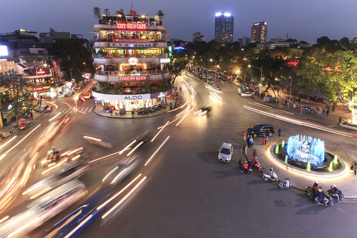 Hanoi, Vietnam: February 23, 2016: Aerial view of Hanoi at twilight at intersection locating next to Hoan Kiem lake, center of Hanoi. Architecture ASIA Built Structure City City Life City Street Cityscape Hanoi Vietnam  Ho Chi Minh Mausoleum Hoan Kiem Lake Illuminated Land Vehicle Landmark Light Trail Mode Of Transport Motion Night One Pillar Pagoda People Road Tourists Traffic Traffic Traffic Jam Vietnam