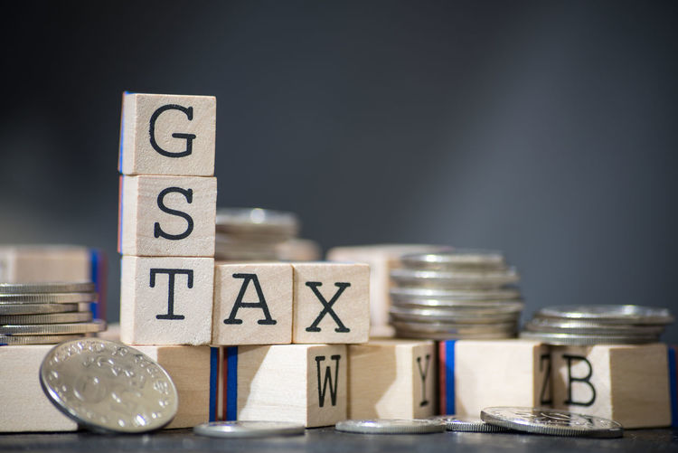 Good and Services Tax Business Cube Wood Close-up Concept Goods And Services Tax Gst Indoors  No People Studio Shot Tax Taxes Wooden