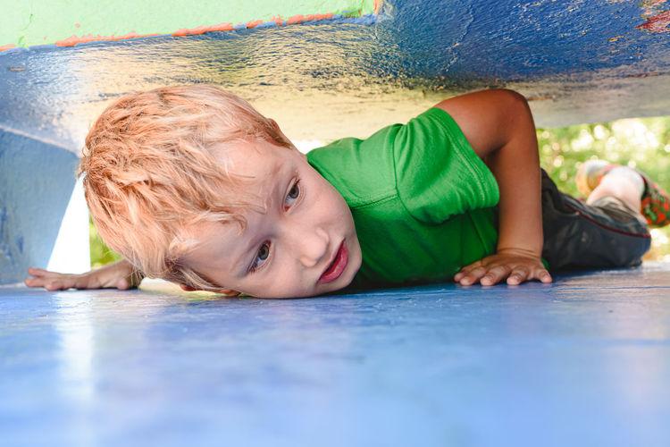 Boy lying down