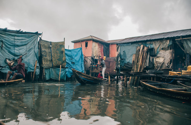 Life on a boat Architecture Building Exterior Built Structure Canal Cloud - Sky Day Fishing Boat Gondola - Traditional Boat Group Of People Men Mode Of Transportation Nature Nautical Vessel Occupation Outdoors Real People Reflection Sky Transportation Water Waterfront