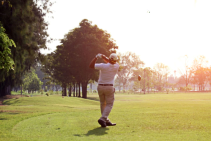 Adult Adults Only Casual Clothing Full Length Golf Golf Ball Golf Club Golf Course Golf Swing Golfer Grass Green - Golf Course Leisure Activity One Man Only One Person Only Men Outdoors People Playing Sport Sports Clothing Standing Taking A Shot - Sport Teeing Off Tree