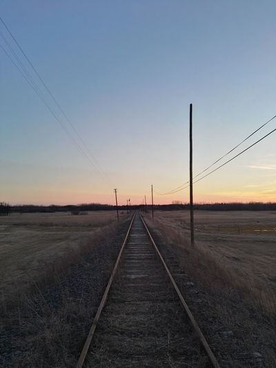 Sunset No People Sky Nature The Way Forward Transportation Lines Train Tracks Columns Wires Notused