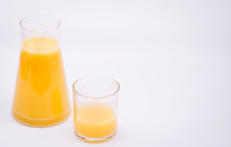 freshly squeezed orange juice Clean Copy Space Cut Out Drink Drinking Glass Food Food And Drink Glass Glass - Material Healthy Eating Household Equipment Indoors  No People Orange Orange Color Orange Juice  Refreshment Still Life Studio Shot Wellbeing White Background Yellow