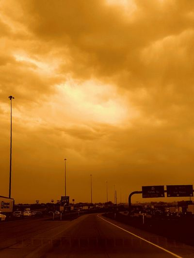 Taken By M. Taken By M. Leith Taken On Mobile Device Street Photography Storm Driving Expressive Sky In The Car Traffic Sepia Hot 43 Golden Moments