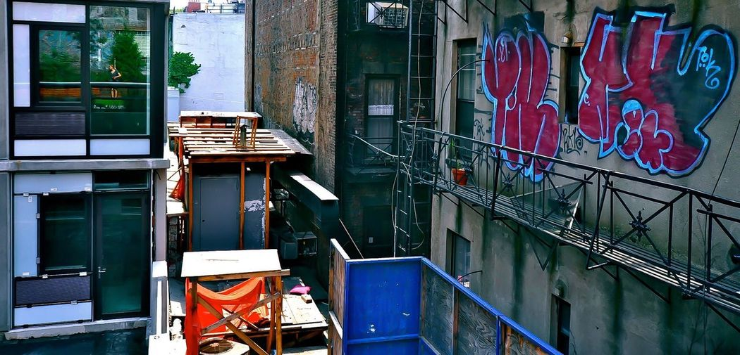Urban Landscape Girl Reflection Reflection Manhattan Urban Geometry New York City EyeEm Selects Built Structure Architecture Building Exterior No People Day Graffiti Building Window City Wall - Building Feature Outdoors