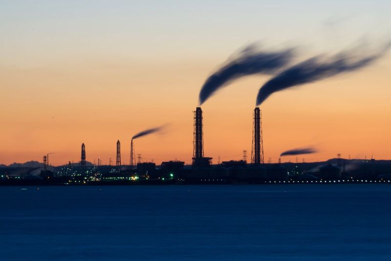 Smoke Stack Industry Pollution Factory Smoke - Physical Structure Air Pollution Emitting Built Structure Fumes Chimney Architecture Sunset Environment Sky Building Exterior No People Tall Waterfront Power Station Outdoors