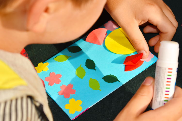 Close-up of boy doing craft on table