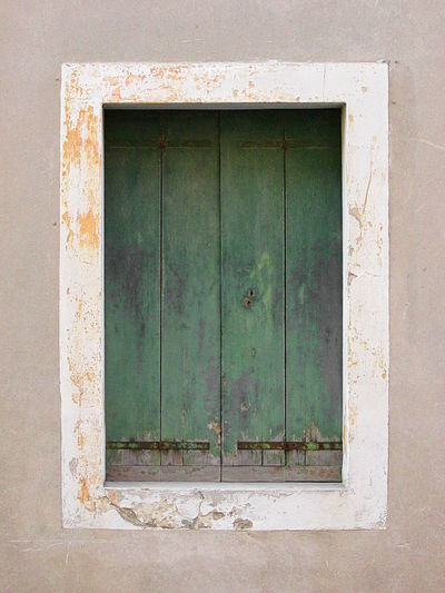 Close-Up Detail of Weathered Green Wooden Window 2016 Abandoned ArchiTexture Backgrounds Bad Condition Closed Day Deterioration Green No People Obsolete Old Protection Scratched And Cracked Wood Textures And Surfaces Timber Wall Weathered Window Wood Wood - Material Wooden