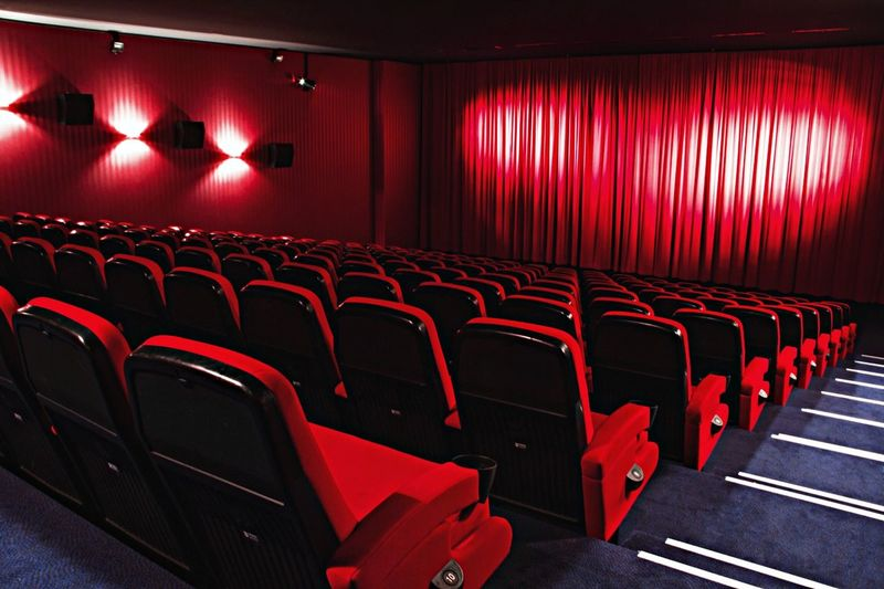 View of red chairs in auditorium