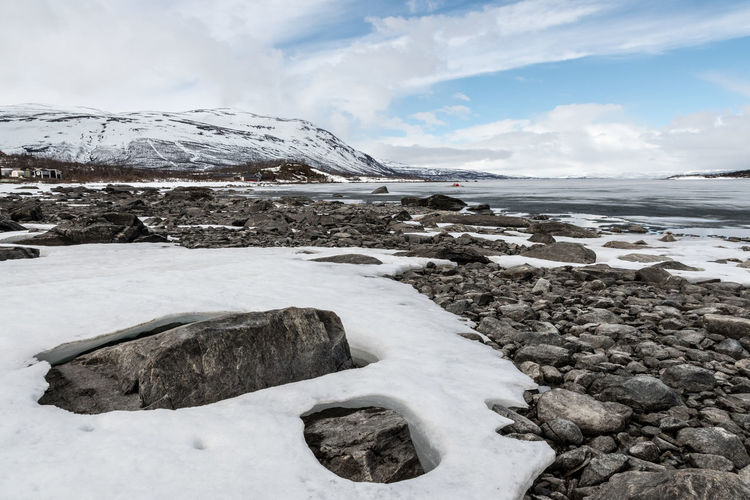 Ice and rocks Abisko Abisko Beauty In Nature Cold Temperature Day Frozen Glacier Ice Iceberg Mountain Nature No People Outdoors Scenics Sea Sky Snow Sweden Tranquil Scene Tranquility Water Winter