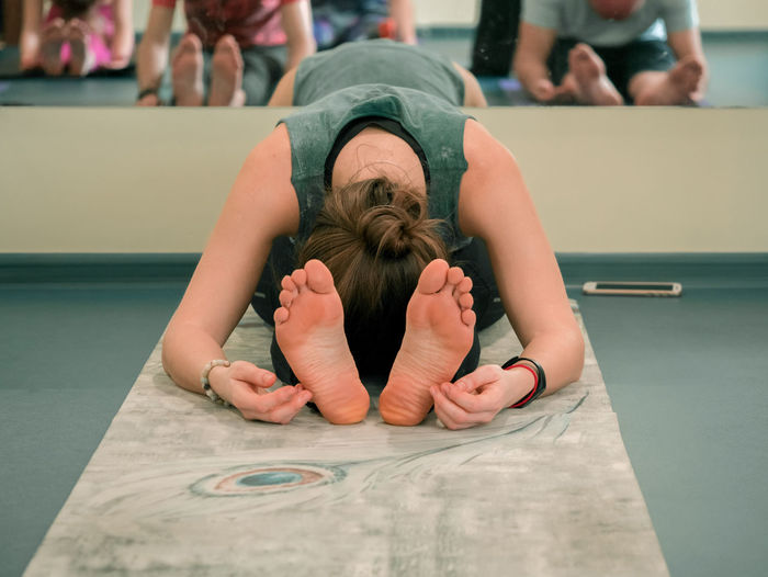 Woman doing yoga at studio