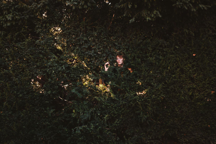 Beauty In Nature Boy Hedge Man Nature Night Outdoors Portrait Real People Young Man