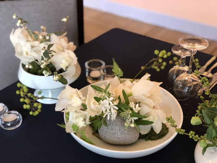 High angle view of white roses in vase on table