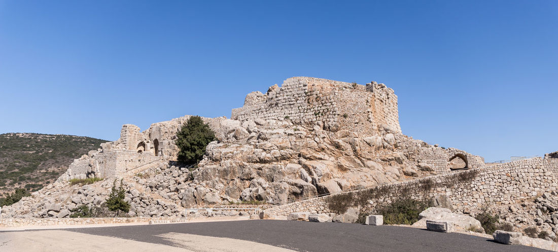 Remains of the Nimrod Fortress located in the Upper Galilee in northern Israel on the border with Lebanon. Israel Nimrod Fortress Saladin Beybars Crusaders Ayubids Mamluks Assassins History Heritage Castle Travel Destinations National Park Tourist Attraction  Hill Stone Wall Entrance Gate Tunnel Old Ancient Loophole Medieval Architecture Ruins Protection