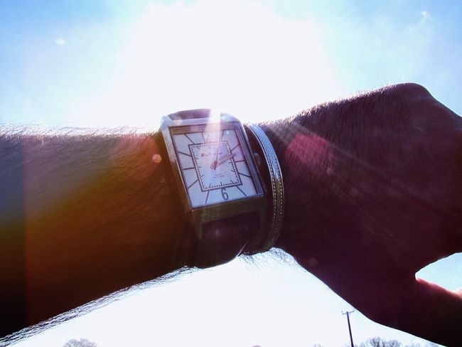 Spring, time Watch Face Time Time Piece Watch Real People One Person Sky Sunlight Day Human Hand Human Body Part Hand Sunbeam Lens Flare Outdoors Unrecognizable Person Men Close-up