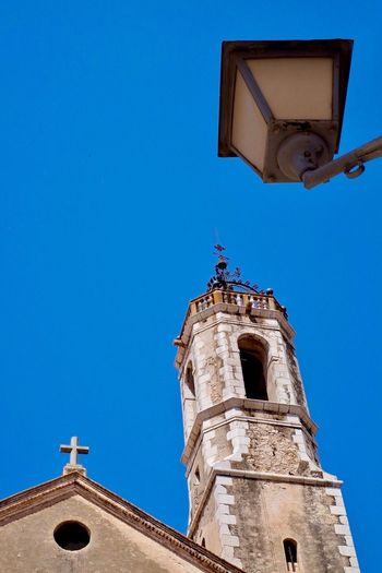 Religion Architecture Low Angle View Spirituality Blue Place Of Worship Clear Sky History Built Structure Building Exterior Outdoors Day Bell Tower No People Lamp Blue Sky Vilanovailageltru España SPAIN