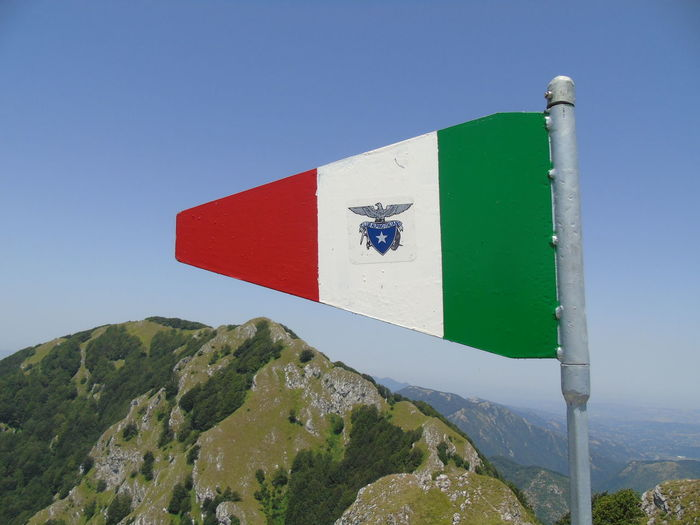 Italian flag against mountains