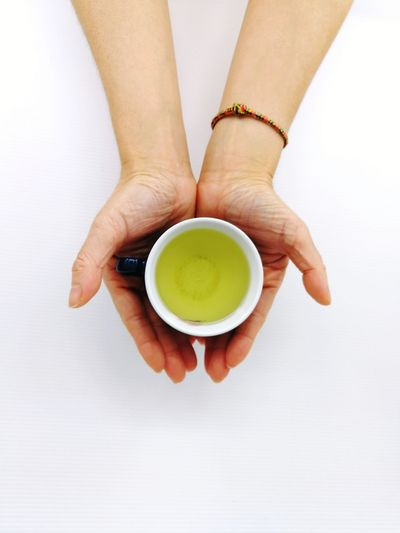 tea Human Hand Drink Tea - Hot Drink Young Women High Angle View Studio Shot Women Close-up Food And Drink Japanese Tea Cup Tea Cup Served Green Tea Tea Beverage Matcha Tea Tea Ceremony Herbal Tea Afternoon Tea Teapot Chinese Tea Ground Coffee