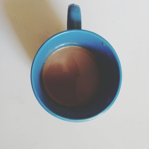 High angle view of black coffee on white background