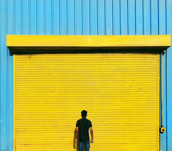 Yellow Architecture One Person Built Structure Building Exterior Wall - Building Feature Real People Rear View Standing Day Full Length