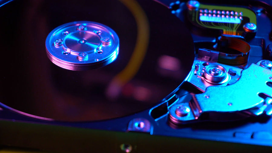 HDD drive opened Technology Record Close-up Turntable Control Music No People Indoors  Equipment Arts Culture And Entertainment Audio Equipment High Angle View Illuminated Sound Recording Equipment Retro Styled Control Panel Blue Focus On Foreground Compact Disc Nightlife Electrical Equipment Mixing