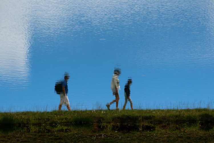 Stroll above the lake... Blue Day Getting Creative Getting Inspired Grass Green Color Lake Lakeshore Leisure Activity Lifestyles Nature Non-urban Scene Outdoors Pivotal Ideas Reflection Tranquil Scene Tranquility Vacations Water Water Reflections Color Palette Silhouettes